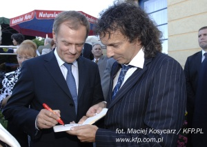 Polish Prime Minister, Donald Tusk, creating a Smile for Marek's Project Smile